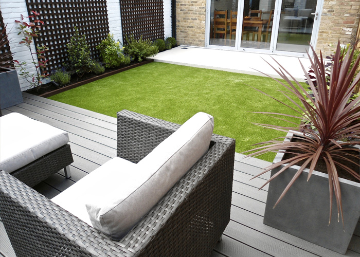 Grey decked garden seating area
