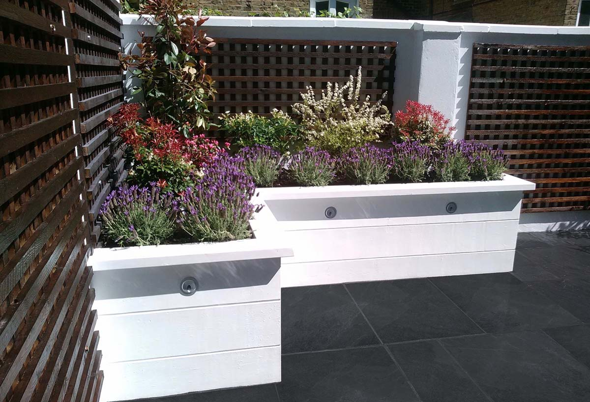 White rendered planters Clapham