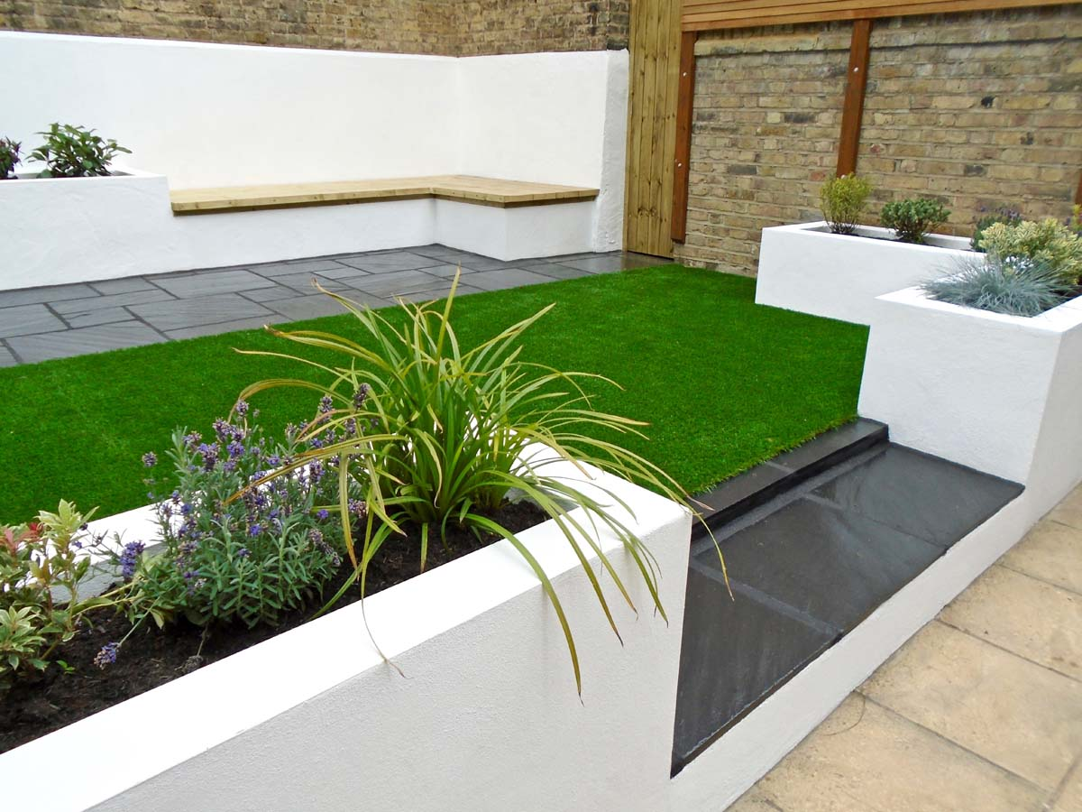 Patio garden with white rendered seating