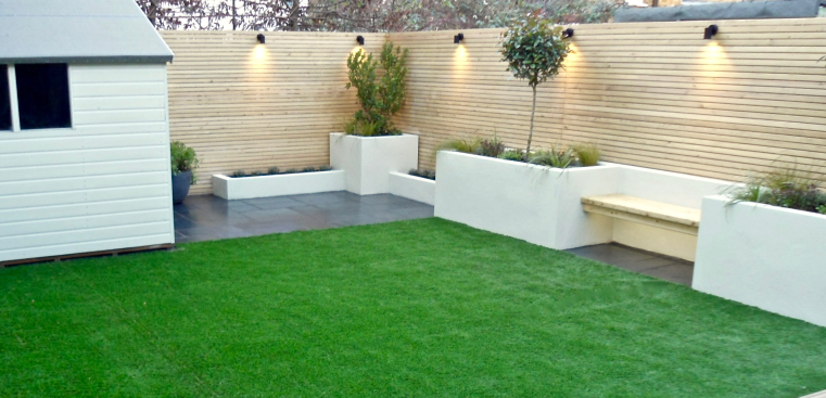 White rendered garden seating area