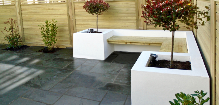 Grey patio with white seating area